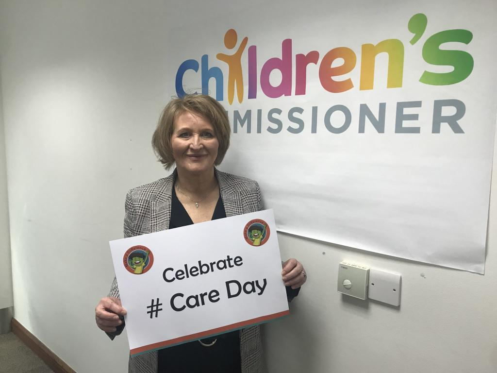 Anne Longfield the Children's Commissioner for England holds a placard saying Celebrate Care Day